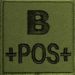 Groupe sanguin B positif brodé sur tissu vert OD
