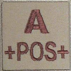 Groupe sanguin A positif brodé sur tissu tan